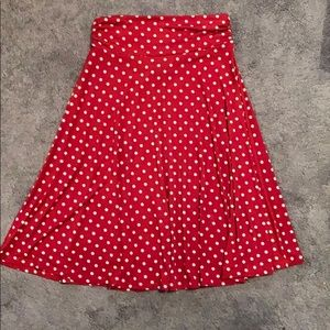 Red with white polka dot skirt